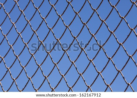 Chain link fence and blue sky.