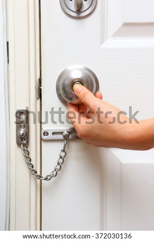 chain lock and knob lock in door for protect home