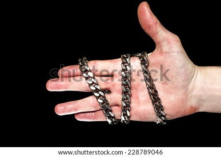 Chain on a hand - stock photo