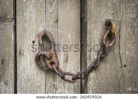 chain on a old door  - stock photo