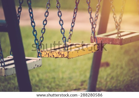 Chain swing in playground. Vintage filter. - stock photo