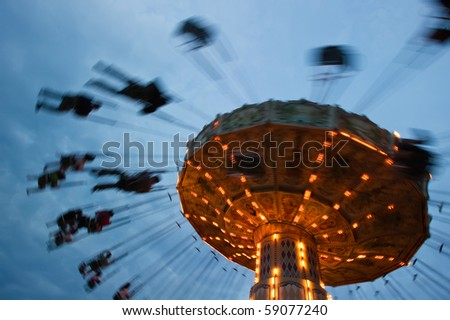 chain swing ride in amusement park - stock photo