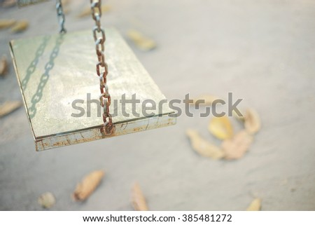 Chain swings hanging in garden,soft vintage toned picture. - stock photo