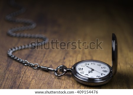 Chain watch and time going by - stock photo