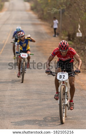 CHAINAT, THAILAND - MARCH 9 : Surachet Singjui riding a Mountain bike Cross country at Thailand Championship 2014 Race 3 on March 9, 2014 at Khaoprong Track in Chainat, Thailand.