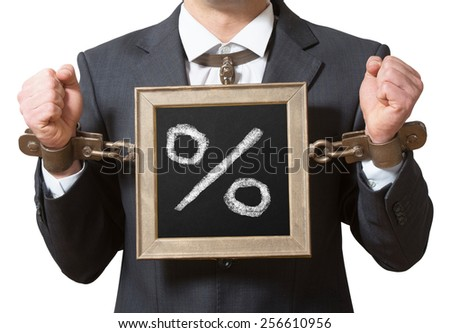 Chained businessman with a board, credit concept - stock photo
