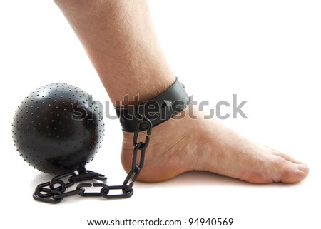 Chained foot with ball isolated over white - stock photo