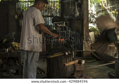 CHAING MAI,THAILAND-MAY 26,2016: Blacksmith work a Retro smithy in Chiang Mai province Thailand.