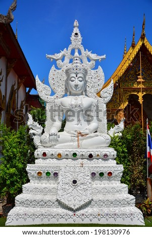 CHAING MAI, THAILAND - MAY 11, 2014 : White Buddha at Wat Tung Yu is a small Buddhist monastery near Wat Phra Singh, in the old city of Chiang Mai. It is small, but contains a lot of interesting architectures