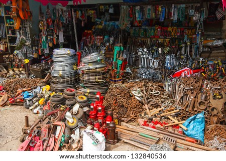 chains, cables, tools, various metal parts in a street shop in Saigon