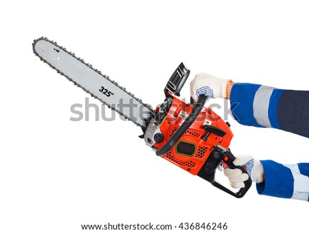 Chainsaw in hand saws a log. isolated - stock photo