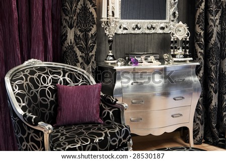 chair, a candlestick and a clock in a wealthy home
