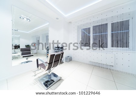 chair and mirror in modern hairdressing - stock photo