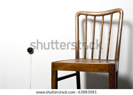 chair and plug on the wall - stock photo