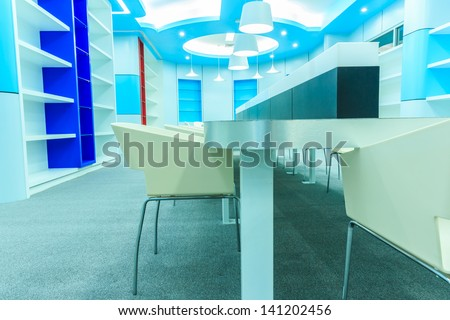 chair and table in empty modern library - stock photo