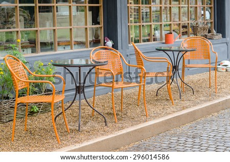 Chair and table in front of a cafe