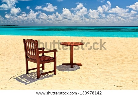 Chair and table on coral sandy beach, Maldives, The Indian Ocean, island Kuredu - stock photo