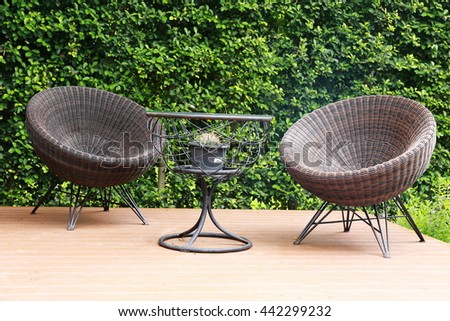 chair and table set in garden - stock photo