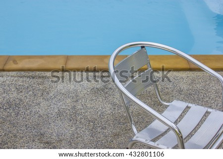 chair beside swimming pool