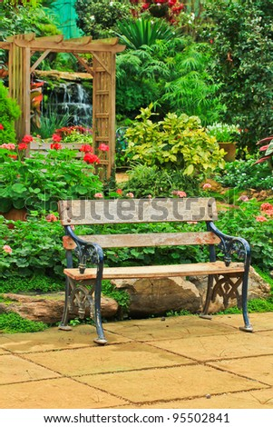 Chair in the garden. - stock photo