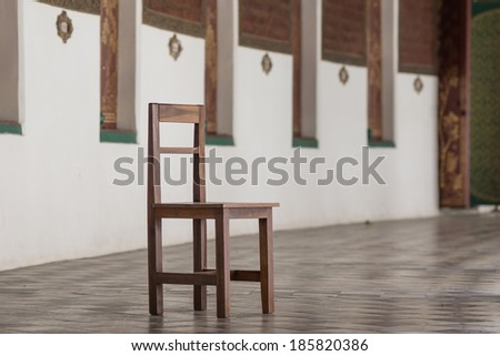 Chair in the middle school hallway. - stock photo