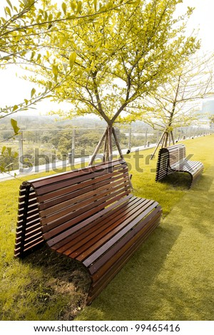 Chair in the small garden on the building. - stock photo