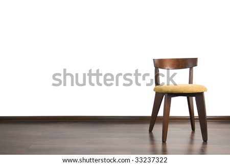 Chair is located in the empty room on the white background. - stock photo
