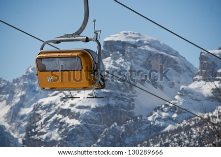 Chair Lift for skiers in winter snow time