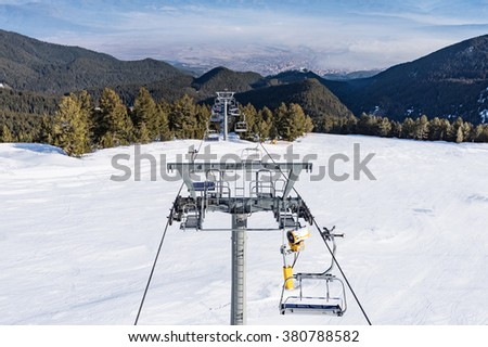 chair lift for skiing in the mountains in winter - stock photo