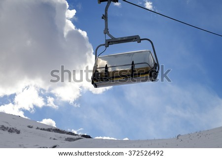 Chair-lift in ski resort at sun evening. Greater Caucasus, Mount Shahdagh. Qusar rayon of Azerbaijan.