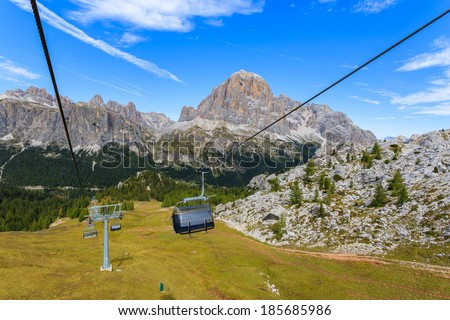 Chair lift to Cinque Torri in autumn time with mountain valley in background, Dolomites, Italy