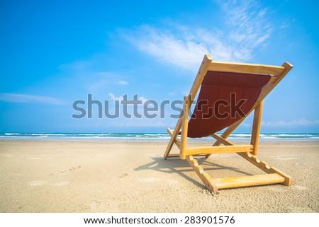 Chair on a beautiful tropical beach  - stock photo