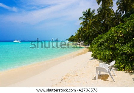 Chair on tropical beach - abstract vacation background