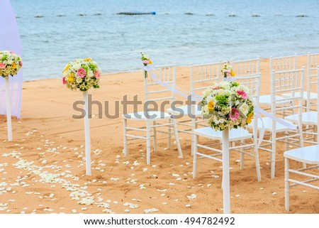 chair setting with flower decoration for wedding at the beach