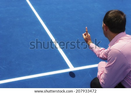 Chair umpire look at mark on court and says ball was OUT. Hard surface like on USA Tennis Tour, US Open, Cincinnati, Indian Wells, Montreal, Toronto, Atlanta and Dubai open. Copy space available. - stock photo