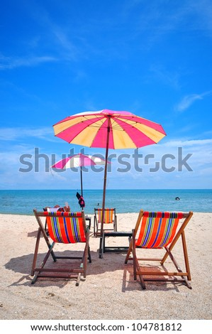 chair under umbels on the beach thailand