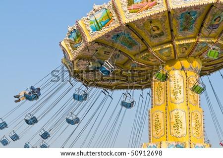 Chairoplane carousel flying around - stock photo