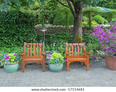 Chairs among lush greenery create a rest area in the park