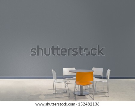 chairs and a table in front of a gray wall with space to paste your own images - stock photo