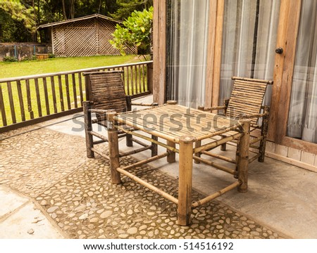 chairs and a table made of bamboo in the summer garden