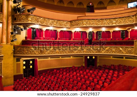 chairs and balcony in classic theater performance hall - stock photo