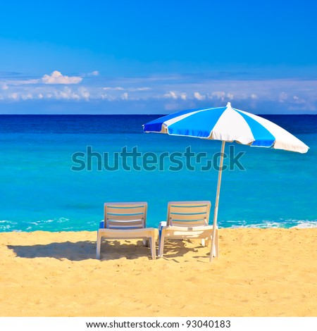 Chairs and parasol on the beautiful cuban beach of Varadero - stock photo