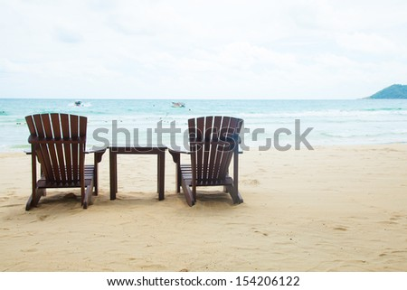 Chairs and table. Located on the sandy beach. Attached to the sea during the holidays.