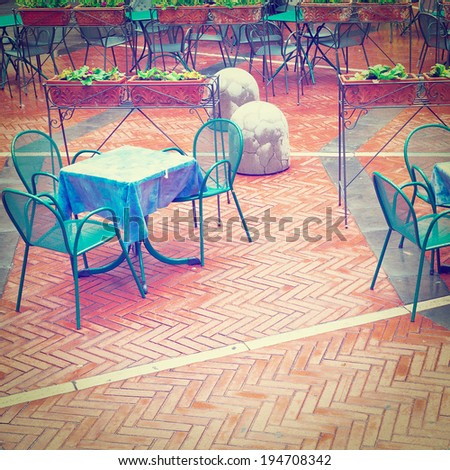 Chairs and Tables in a Street Cafe, Retro Effect - stock photo