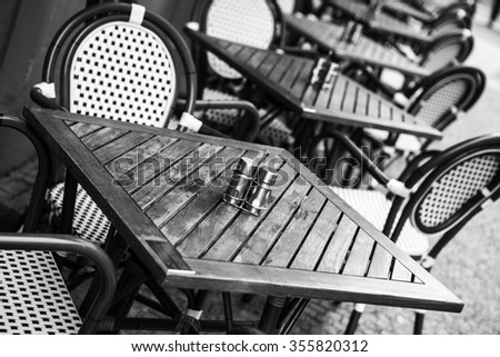 Chairs and tables in outdoors caffe on day