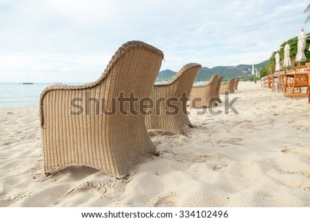 Chairs and tables on the beach Near the sea Relaxing on the beach - stock photo