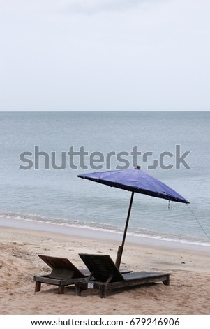 Chairs and Umbrella and table on beach