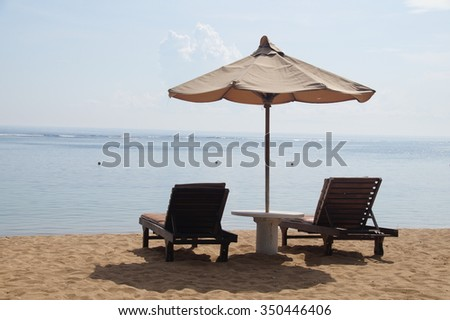 Chairs and Umbrella on a Beautiful beach  - stock photo