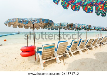 Chairs and umbrella on a beautiful tropical beach at Koh Lan, Thailand