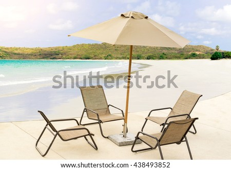 Chairs and umbrella on a beautiful tropical beach at Thailand.